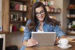 Woman using tablet in cafe royalty free stock images