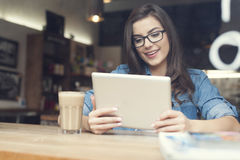 Woman using tablet in cafe Stock Image