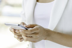 A woman using tablet Stock Images
