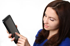 Woman using tablet computer. Young attractive caucasian woman using tablet computer isolated on white background Royalty Free Stock Image