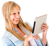 Woman using a tablet computer Stock Photography