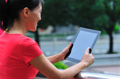 Woman using tablet computer Royalty Free Stock Image