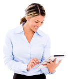 Woman using a tablet computer Stock Images