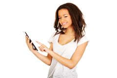 Woman using tablet computer. Royalty Free Stock Images