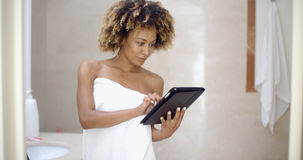 Woman Using Tablet Computer In The Bath Royalty Free Stock Photos