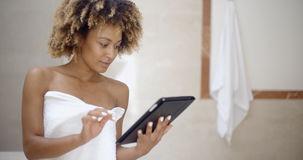 Woman Using Tablet Computer In The Bath Royalty Free Stock Images
