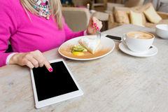 Woman using tablet computer in cafe Stock Image