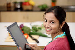 Woman using a tablet computer Stock Photo