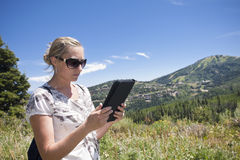 Woman using tablet computer outdoors Royalty Free Stock Image