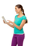 Woman Using Tablet Computer Over White Background Royalty Free Stock Photography