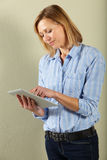 Woman using tablet computer in studio Royalty Free Stock Photography