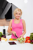 Woman using a tablet computer to cook Royalty Free Stock Photos