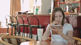 Woman using tablet computer. Touchscreen in cafe on cruise ship stock footage