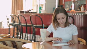 Woman using tablet computer. Touchscreen in cafe on cruise ship stock video footage