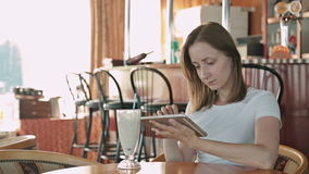 Woman using tablet computer. Touchscreen in cafe on cruise ship stock video
