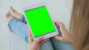 Free Woman Using Tablet Computer With Green Screen Stock Images - 82366124
