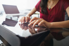 Woman using tablet computer for daily work in office Stock Photo