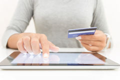 Woman using tablet and credit card pay shopping. Online Stock Photo