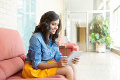 Woman using tablet Royalty Free Stock Photo