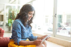 Woman using tablet Royalty Free Stock Images