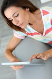 Woman using tablet from home stock images