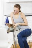 Woman using tablet in the kitchen Stock Photography