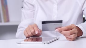 Woman using tablet for on line purchase with credit card stock video footage