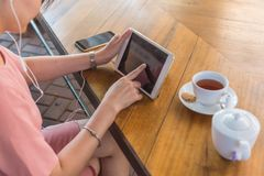 Woman using tablet, listening to music royalty free stock photos