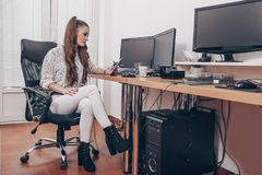 Woman using a tablet in office royalty free stock photos