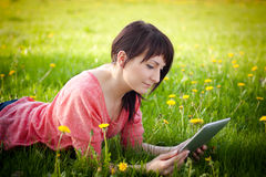 Woman using tablet outdoor Stock Photos