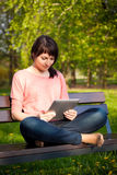 Woman using tablet outdoor Stock Photo
