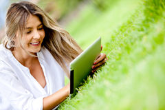 Woman using a tablet outdoors Royalty Free Stock Images