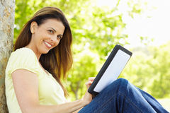 Woman using tablet outdoors Stock Photos