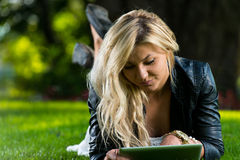 Woman Using Tablet Outdoors Royalty Free Stock Photo