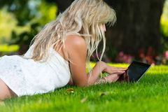 Woman Using Tablet Outdoors Stock Image