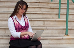 Woman using tablet pc Royalty Free Stock Images