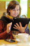 Woman using tablet pc in cafe Stock Photos