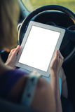 Woman using tablet pc in the car Royalty Free Stock Photography