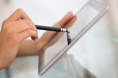Woman using tablet pc with digitized pen.close-up hands. Female working with stylus on digital tablet pc Stock Image
