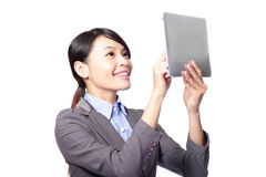 Woman using tablet PC by finger Stock Images