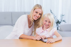 Woman using tablet pc with her daughter Stock Image