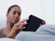 Woman using tablet pc at home stock photography