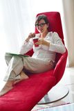 Woman using tablet pc at home Royalty Free Stock Photography