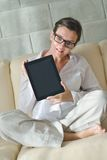 Woman using tablet pc at home Stock Photos