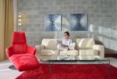 Woman using tablet pc at home Royalty Free Stock Image