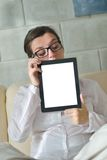 Woman using tablet pc at home Stock Images