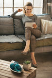 Woman using tablet pc in loft apartment Stock Photography