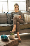 Woman using tablet pc in loft apartment Royalty Free Stock Photography