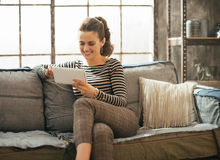 Woman using tablet pc in loft apartment Stock Photos