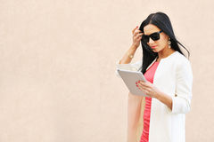 Woman using tablet pc outdoors. Beautiful woman using tablet pc outdoors stock photo